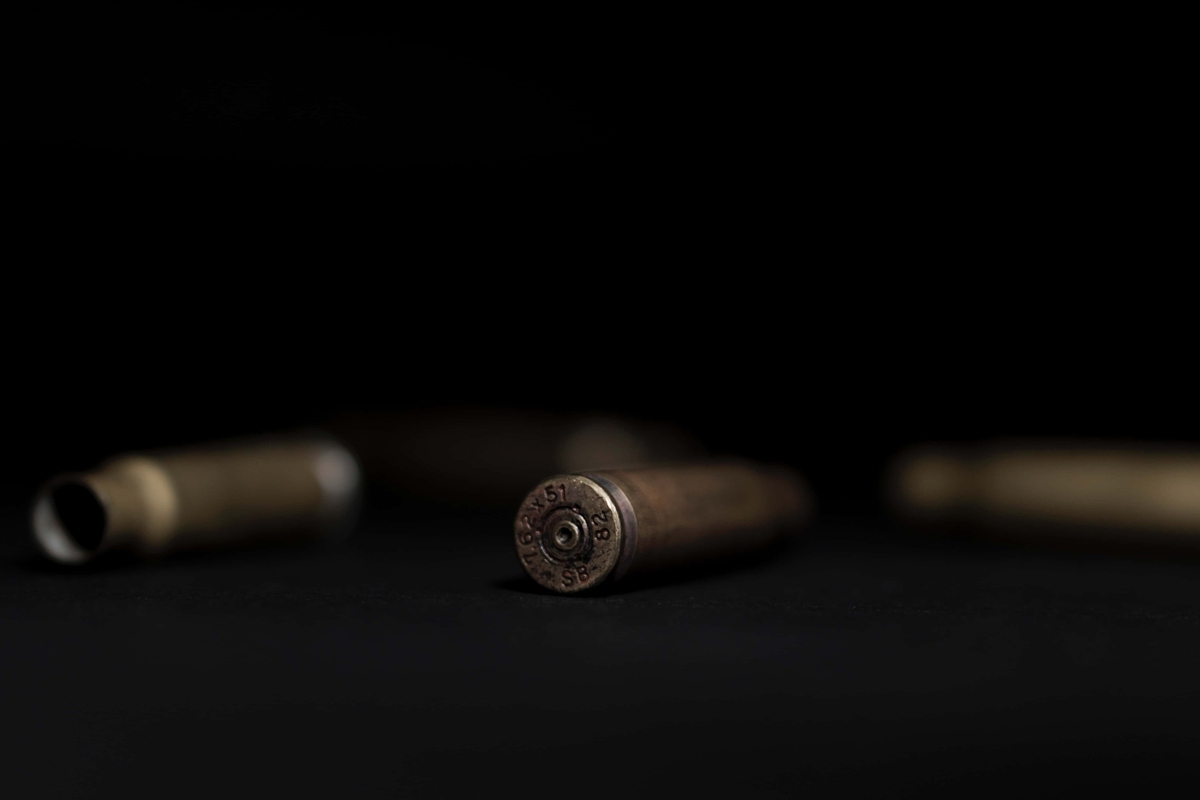 Closeup of some bullets lying on a desk
